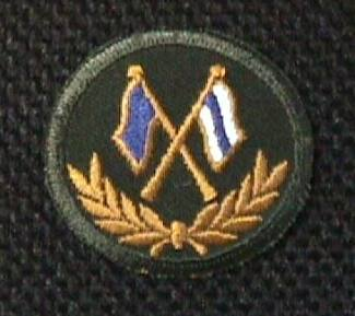 [Signal Corps badge]