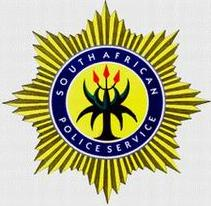 [South African Police Service badge]